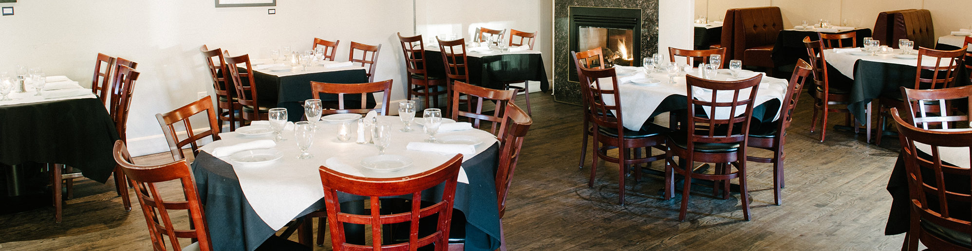 Round tables and seating at The Local
